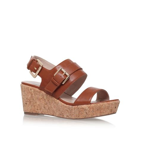 carvela kurt geiger samson mid heel wedge sandals in brown