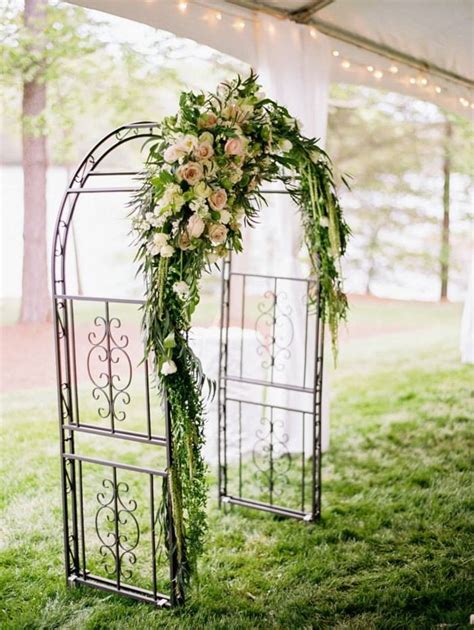 Wedding Arch With Hanging Flowers by Wrought Iron Arch With Asymmetrical Florals