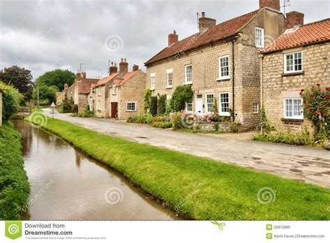 English Cottage Plans by Quaint Cottages And Stream In An English Village Stock