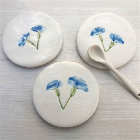 handmade ceramic coasters with blue flowers by