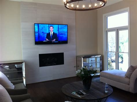 mounted tv fireplace tv mounted a marble tile fireplace yelp