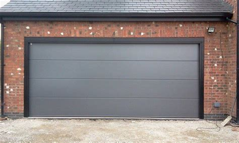Garage Doors Companies by Steel Sectional Doors The Garage Door Company