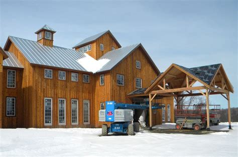 house barn combo floor plans natural stained board and batten siding with a metal roof