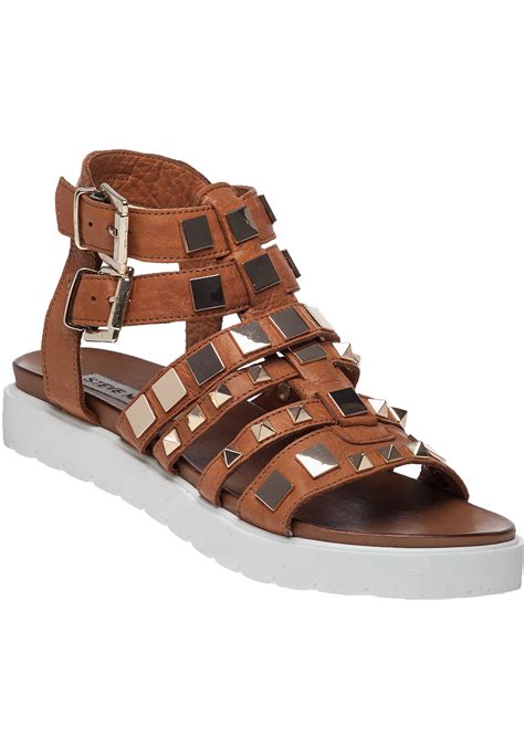 steve madden sandal lyst steve madden bettee leather caged sandals in brown