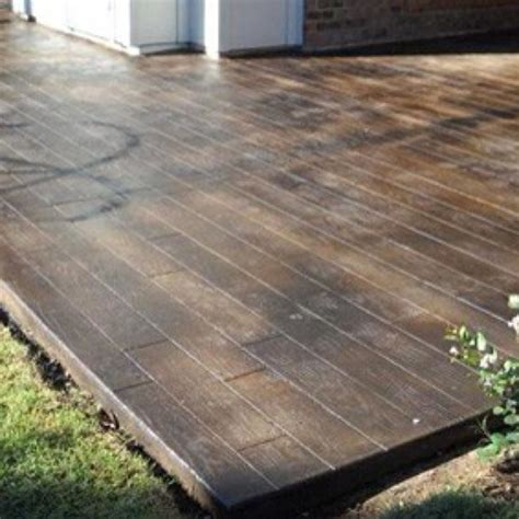 Wood Patio Flooring by Scored And Stained Concrete To Look Like Wood Floors On