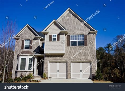 light brick house a light brown brick house under a deep blue sky stock photo 23804134 shutterstock