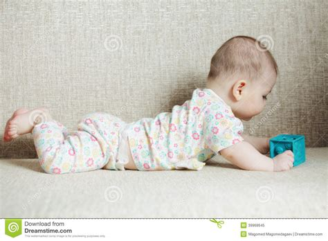 baby on couch baby with cube on sofa stock photo image 39968645