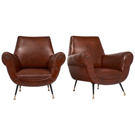 mid century modern italian studded armchairs jean marc fray
