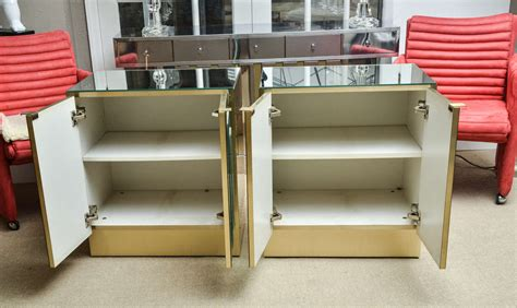 pair of vintage nightstands with mirrored doors by ello at