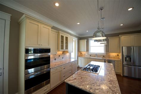 tongue and groove wainscot backsplash traditional maple cabinets stone backsplash and granite countertops