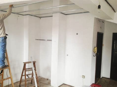 How To Lower Ceiling Height by Renovation Of A Studio Flat Investconsult