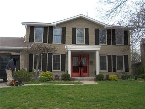 brick house with kelly moore red door green house red door front door painted in benjamin