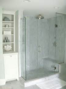 seaside bathroom with seamless glass shower with marble