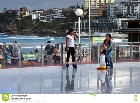 girls ice skating on bondi ice rink editorial image