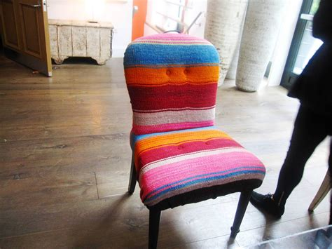 design idea  colorful mexican blanket covered chair warms   crosby street hotel lobby