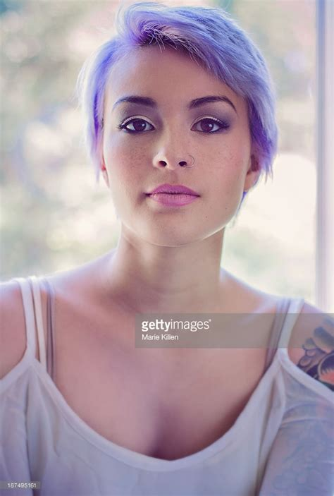 Portrait Of Girl With Lavender Pixie Cut Hair Stock Photo