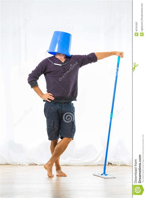 Standing Shoes For Work by Young Man Mopping The Floor Stock Image Image 42761507