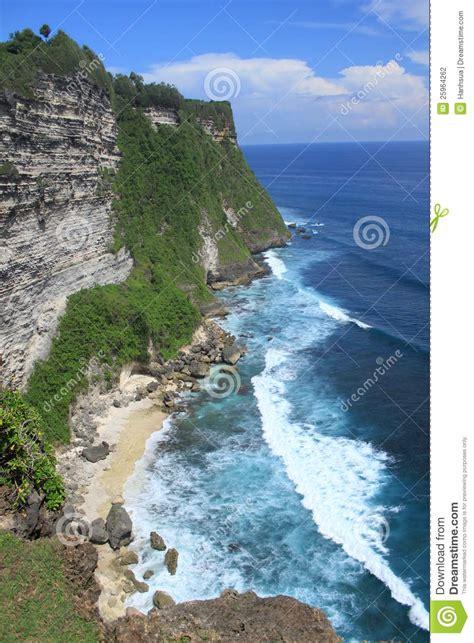 cliff bali cliff in bali island uluwatu stock photography