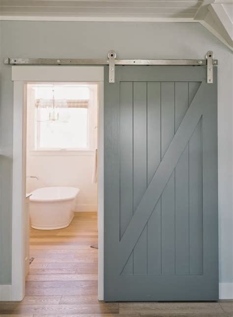 Sliding Barn Door Frame Gray Walls Frame A Gray Sliding Barn Door Which Opens To Reveal A Beautiful Bathroom Featuring A