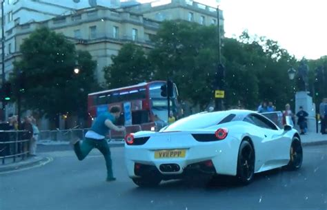 chaising cars drunk guy has epic fail while chasing cars of the london