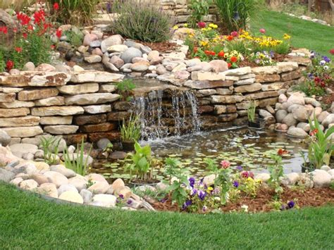 stone waterfalls backyard backyard landscaping house design with small ponds surrounded by white stone combined