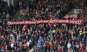 arsenal supporters hold banner  hull city  protest