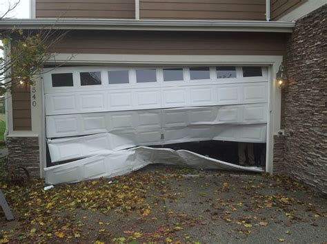 Open Garage Door With Broken by Garage Door Service Repair Minneapolis St Paul Metro