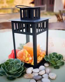 decorating up the lantern centerpieces weddingbee