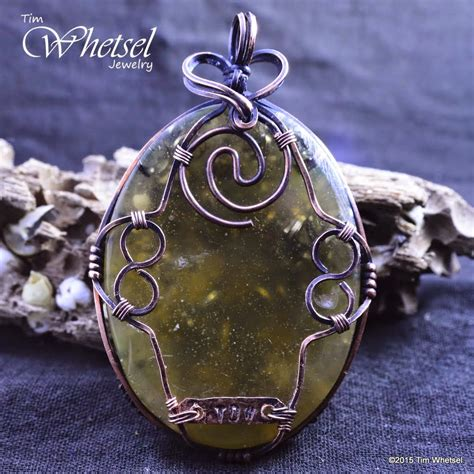 Infinity Pendant Orgonite wire wrapped jewelry by tim whetsel glow in the tree