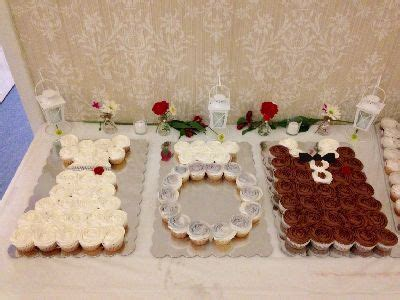 Bridal shower cupcake display that honors the bride, groom