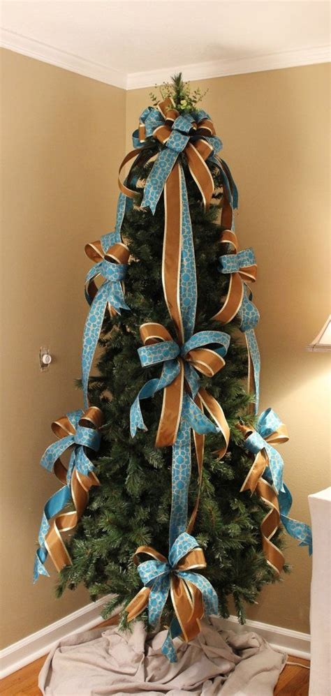 criss cross ribbon with bows on christmas tree blue brown designer tree bow set the ribbon trees and tree bows