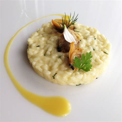 decorare risotto risotto with olive oil and clams with thyme and lemon