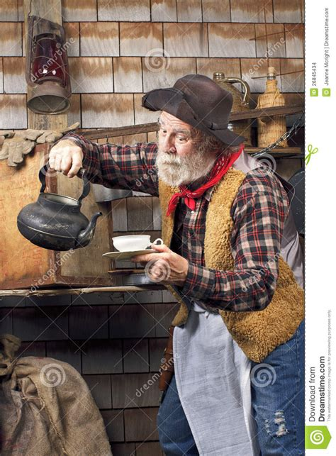 cowboy  kettle  china tea cup stock images