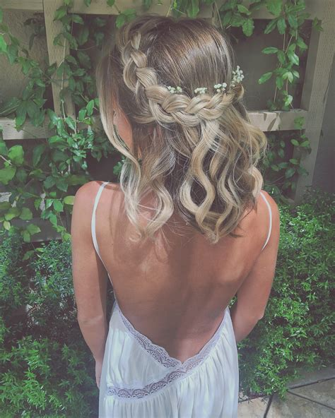 parting hair when braiding a ball braided crown with baby s breath flowers wedding