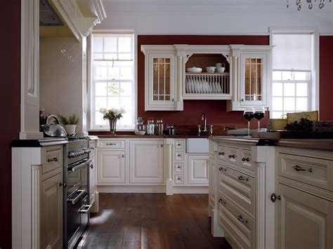 White Kitchen Wall Cabinets by White Cabinets And Moldings Contrast Perfectly With