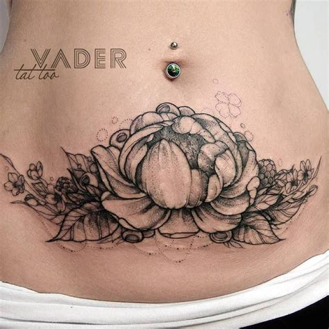 tattoos to cover up stretch marks peony on s stomach to hide stretch marks 3