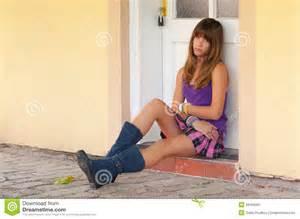images teenage girl: cute sad teenage girl sitting in front of the door stock image image