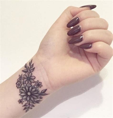 small wrist flower tattoos 33 small meaningful wrist ideas tattoos