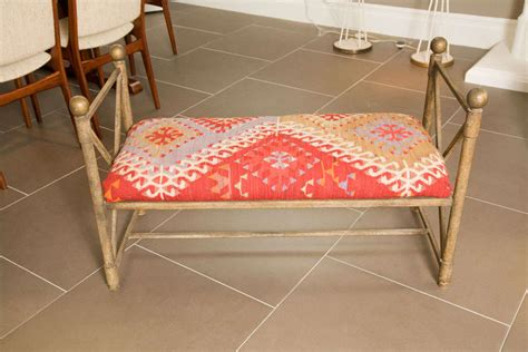 Rug Bench by Vintage Metal Bench Covered In 100 Year Kilm Rug At