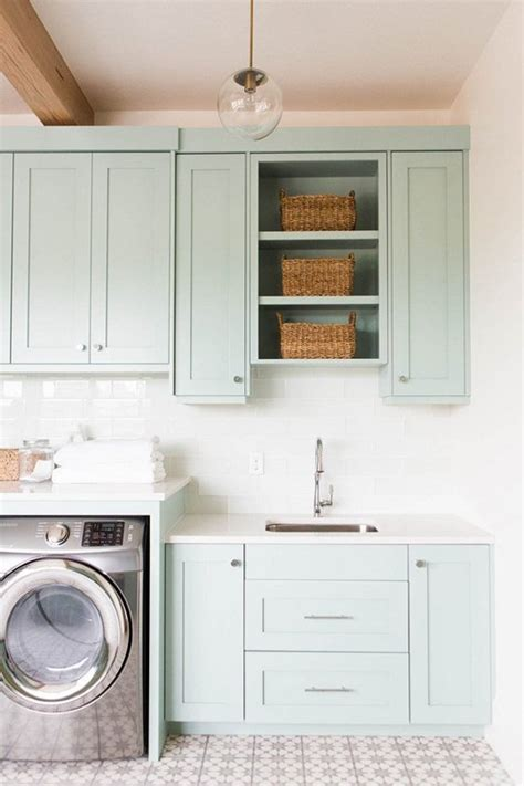cabinets for the laundry room laundry room makeover ideas centsational