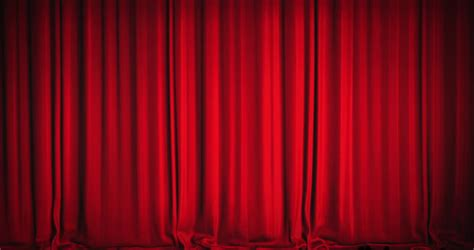 movie drapes a red velvet curtain opening with spotlights in a movie