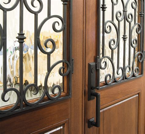 beautiful worldly influenced front doors french doors old world entry door wrought iron grilles pella photo
