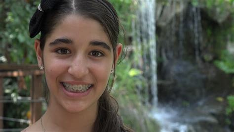 Cute Native Brazilian Girl Looking To The Camera At An