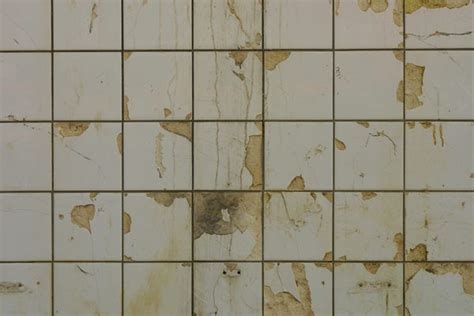 cracked bathroom tile replacing kitchen sink tiles home guides sf gate