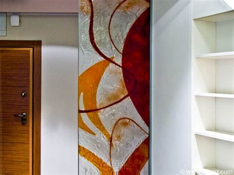 pattern works design studio art glass partition wall in orange and red