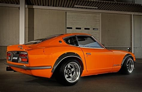 custom nissan 240z custom datsun 240z wide body orange cars pinterest