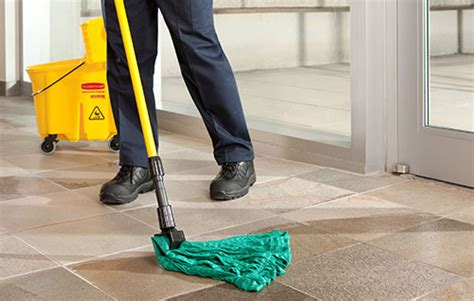 Mopping The Floor by Commercial Floor Dust Mop Rental Service Cintas