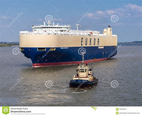 ship car by boat car carrier ship and tug boat editorial photo image of