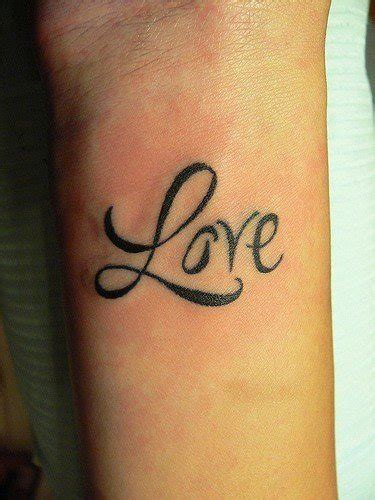 cute love tattoos the word is tattooed onto this s wrist in a