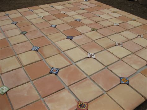 pink laying out patio tile